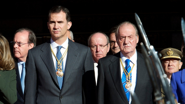 Prince Felipe and King Juan Carlos attend the first parliament session with the new government at the Spanish parliament buildings on 27 December