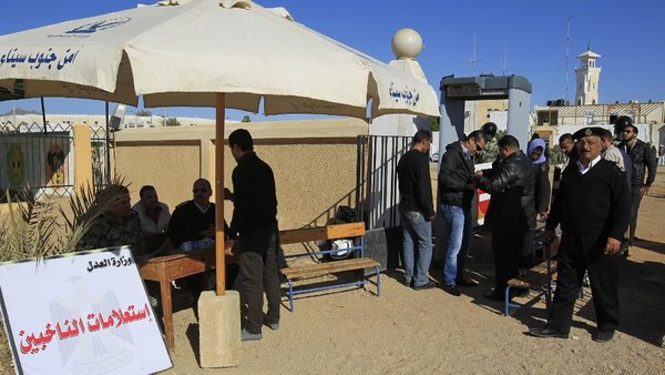 Egyptian voters go through a security inspection at the entrance to a polling station in the Red Sea city of Sharm el-Sheikh