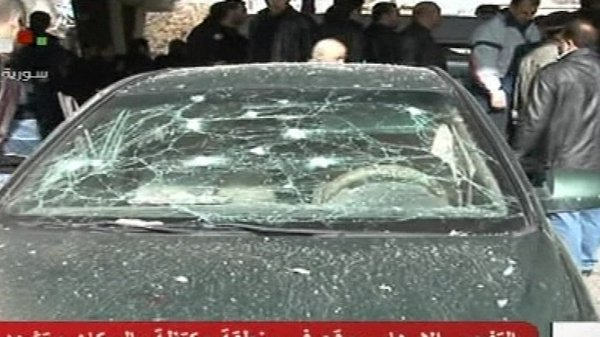 Syrian television showed footage of several damaged cars