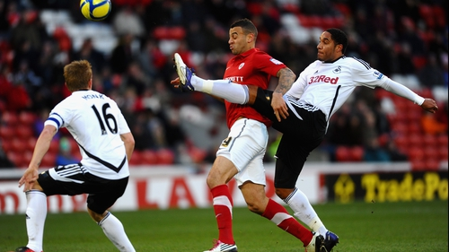 Ashley Williams (R) of Swansea battles with Craig Davies of Barnsley