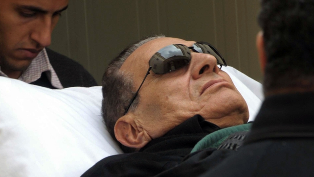 Hosni Mubarak (pictured here at the start of his trial) may face the death penalty