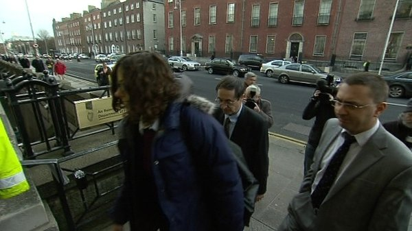 Troika officials arrive at the Department of Finance this morning
