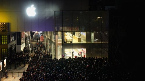 Crowds queued for hours outside Apple stores