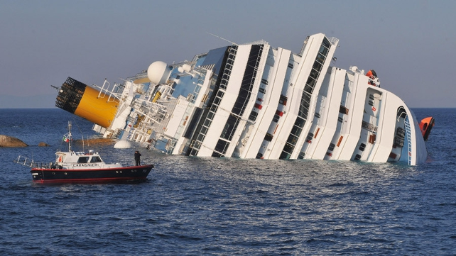 Italian police survey the damaged ship this afternoon