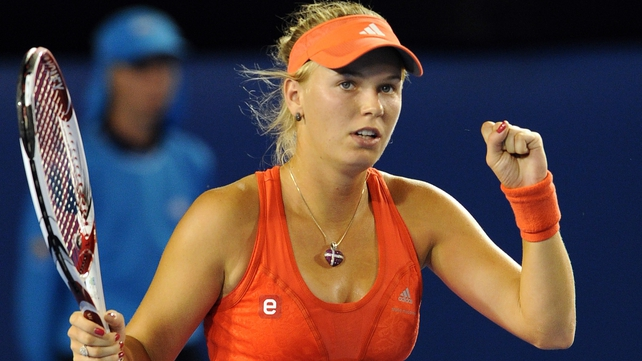 Caroline Wozniacki looked back to her best when beating Anastasia Rodionova in straight sets