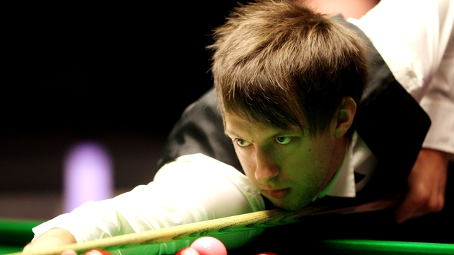 Judd Trump has recovered from a bout of food poisoning but is losing his second round tie with Ali Carter 5-3