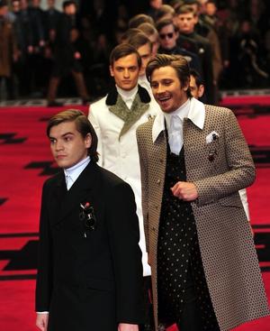 Actors lead a line-up of models down the Prada runway
