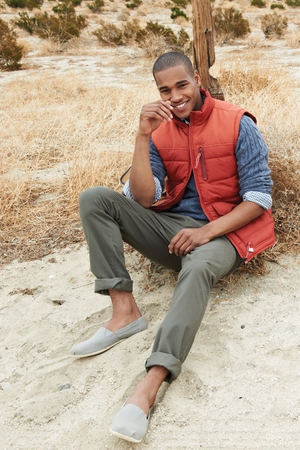 Gilet €59, jumper €53, chinos €42, shoes €23