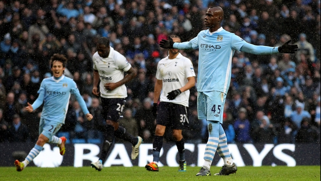 Mario Balotelli celebrates his stoppage-time winner against Spurs