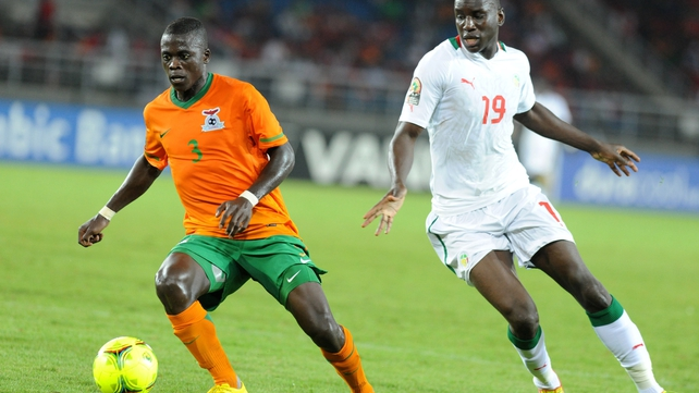 Zambia's Chisamba Lungu (l) shields the ball from Senegal star Demba Ba