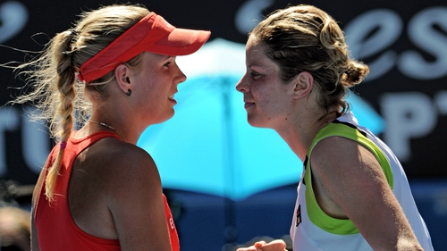 Caroline Wozniacki (l) will lose her world number one ranking after losing to Kim Clijsters (r)