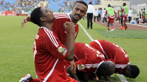 Mohamed Bashir is congratulated by his Sudan team-mates after scoring in Malabo