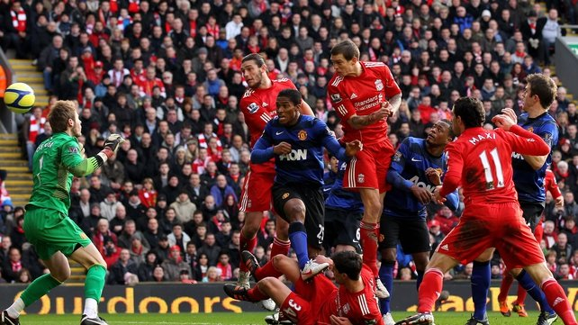 Daniel Agger rises highest to head home the opening goal at Anfield