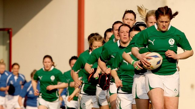 Captain Fiona Coghlan leads out the Ireland team