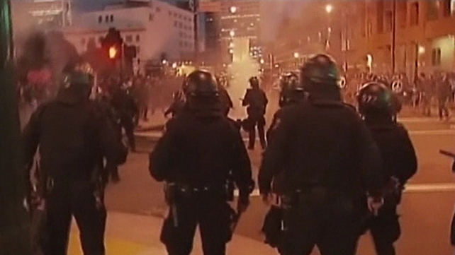 The face-off with riot police began early on Saturday in Oakland