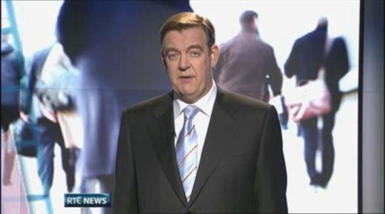 News presenter Bryan Dobson stands to introduce the 'Six One News' in the first broadcast from the new studio.
