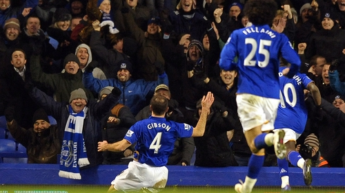 Darron Gibson celebrates with the Everton faithful after his strike against Manchester City