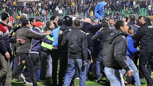 Hundreds injured after fans invaded the pitch