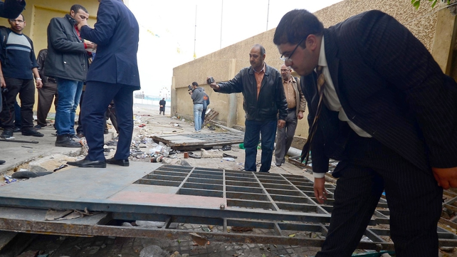 An Egyptian investigation team inspects damages at the Port Said Stadium