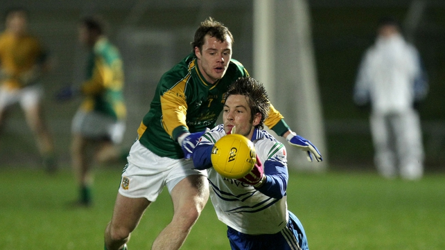 Meath's Cormac McGuinness with James Turley of Monaghan