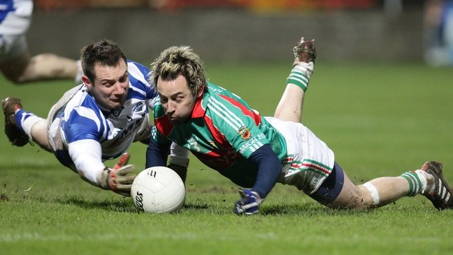 Laois goalkeeper Eoin Culliton stops Mayo's Conor Mortimer in his tracks