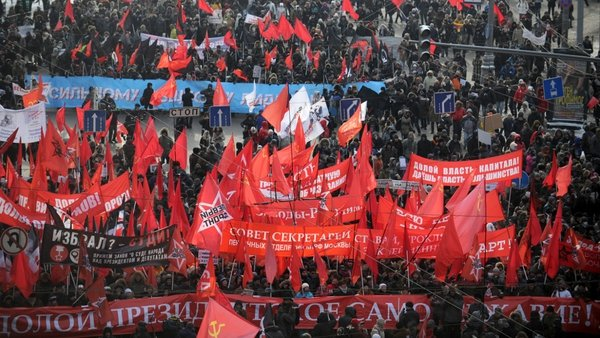 Leftists carry their red flags while marching to take part in a anti-Putin rally in central Moscow