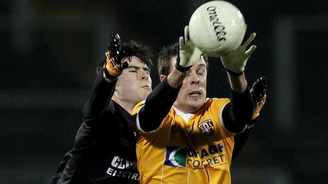 Antrim's James Loughrey contests the ball with Sligo's Pat Hughes