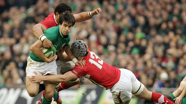 Conor Murray is grabbed by Toby Faletau and Jon Davies