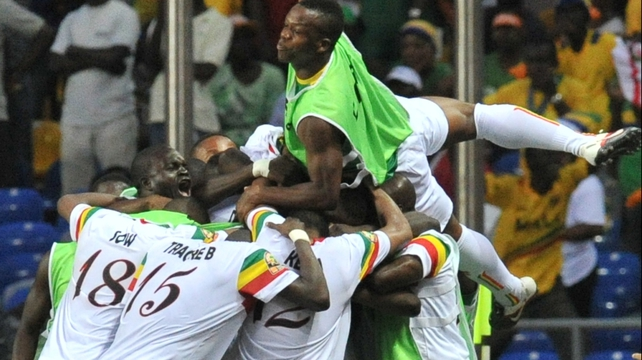 Mali players celebrate after their penalty shoot-out victory in Libreville