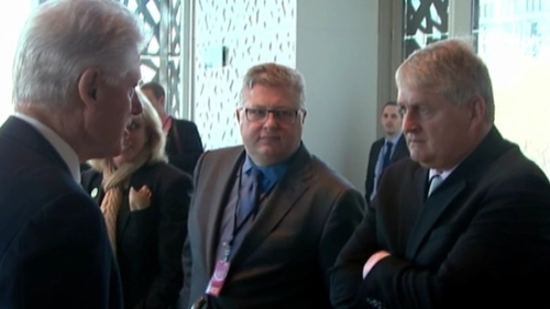 Bill Clinton greets businessman Denis O'Brien