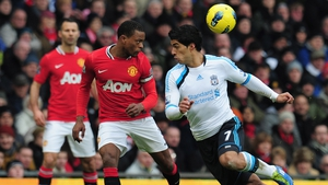 Luis Suarez (R) was banned for eight games for racial abuse of Patrice Evra (C) in 2011