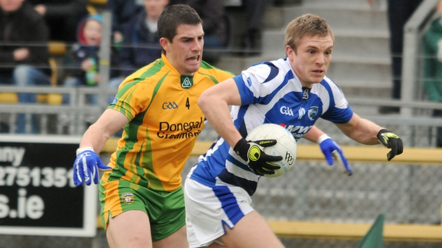 Ross Munnelly is marked by Paddy McGrath during Laois' win over Donegal -their first ever in Ballybofey
