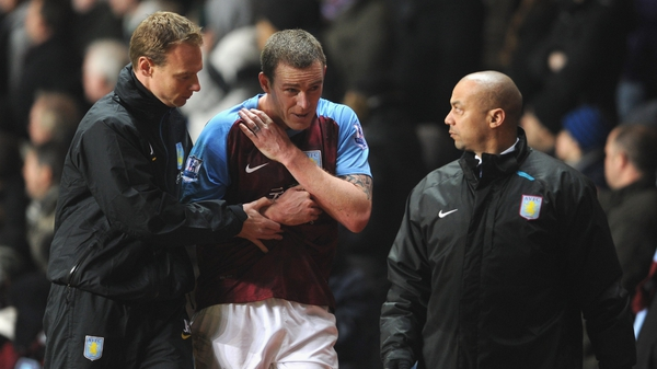 Richard Dunne was visibly in pain as he was forced from the Villa Park pitch