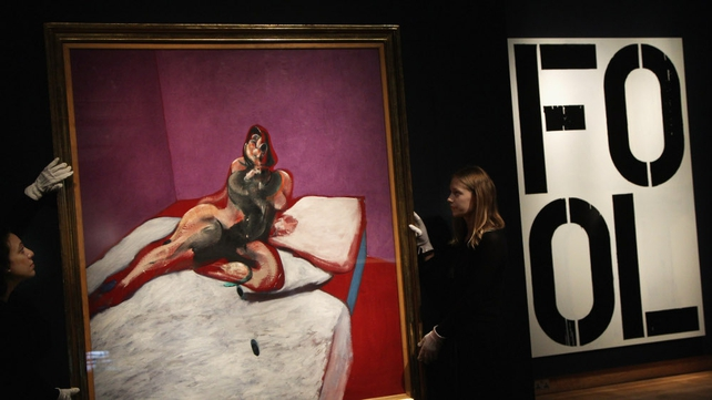 Christie's auction house employees hang a 'Portrait of Henrietta Moraes' by Francis Bacon