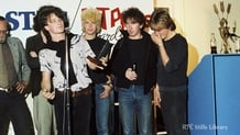 U2 receive a Stag/Hot Press award (1982)  © RTÉ Stills Library 2110/003
