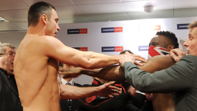 Vitali Klitschko reacts to Dereck Chisora's slap in the face