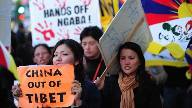 Pro-Tibetan demonstrators protest against Chinese-ruled Tibet in front of a downtown hotel in Los Angeles