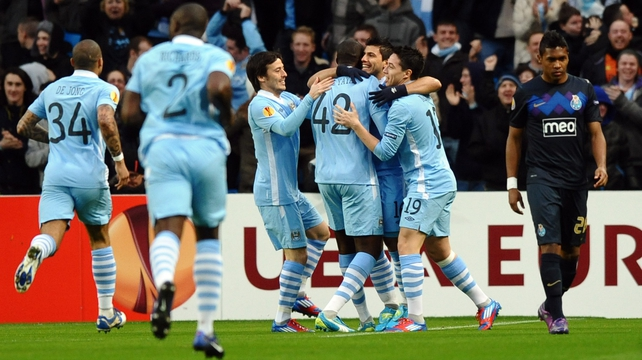 Man City players celebrate Sergio Aguero's opening goal en route to knocking holders Porto out of the Europa League