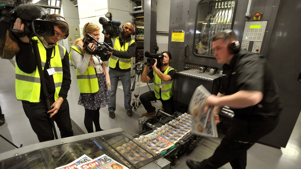 'The Sun On Sunday' newspapers roll off the printing presses