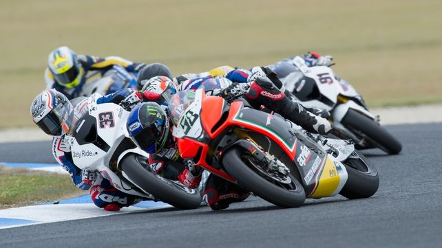 Eugene Laverty (right) of Ireland and Aprilia Racing Team leads Marco Melandri (left) of Italy and BMW Motorrad Motorsport during race one in Phillip Island