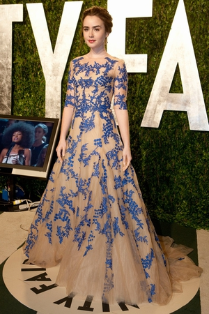 Lily Collins: Taking a huge risk in nude Monique Lhuillier with blue foral appliqué, Lily looks dazzling in this brave gown