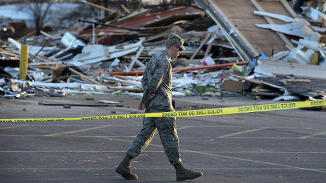 National Guard members are assisting in the clean-up operation