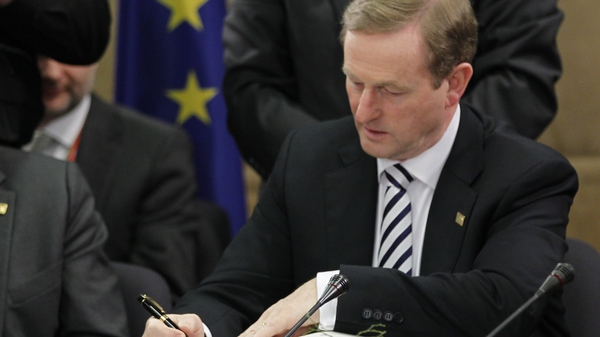 Enda Kenny signed the treaty in Brussels this morning