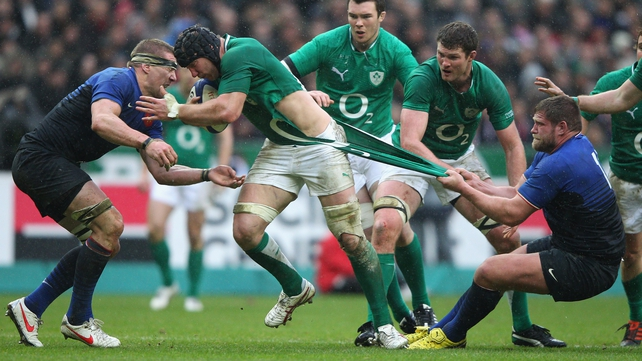 Stephen Ferris battles for a few more yards, and has his jersey ripped