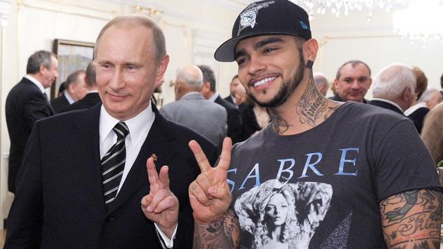 Vladimir Putin celebrates his victory with rapper Timati