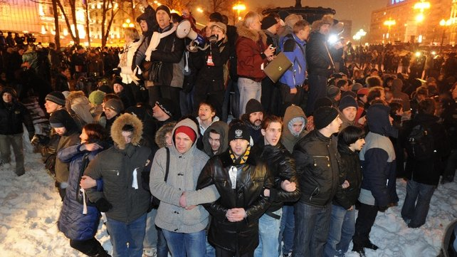 Protesters gathered on a fountain in Pushkin Square
