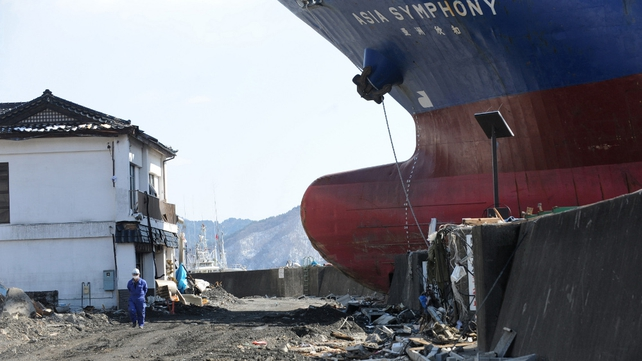 A ship called Asia Sympathy ran aground in Kamaishi, Iwate Prefecture photographed on 18 March 2011