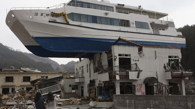 A catamaran was washed by the tsunami onto a two-storey home in Otsuchi, Iwate prefecture
