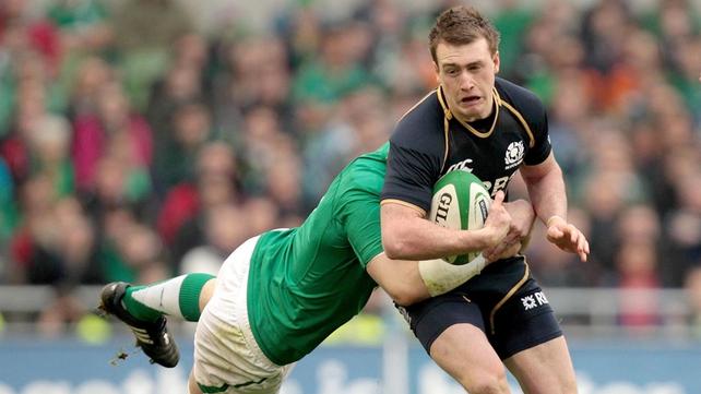 Peter O'Mahony tackles Stuart Hogg