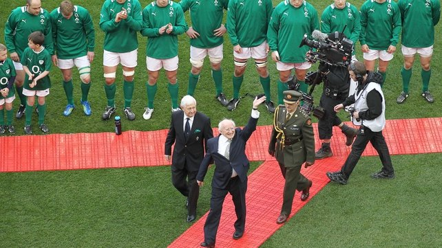 President of Ireland Michael D Higgins waves to the crowd